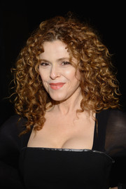 Bernadette Peters stuck to her trademark tight curls when she attended the DKNY 30th anniversary fashion show.
