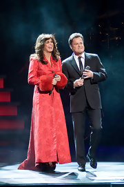 Marie Osmond hit the stage for 'Donny and Marie: Christmas in Chicago' in a red brocade evening coat with fur-trimmed cuffs.