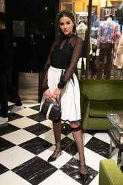 Olivia Culpo paired her top with a flared white mini skirt.