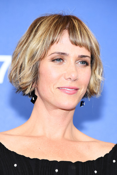 Kristen Wiig sported a tousled bob with baby bangs at the Venice Film Festival photocall for 'Downsizing.'