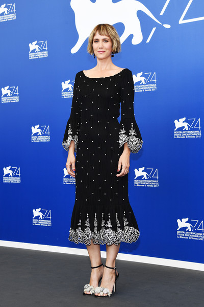 Kristen Wiig oozed elegance wearing this Prabal Gurung pearl-studded midi dress with an embroidered hem and cuffs at the Venice Film Festival photocall for 'Downsizing.'
