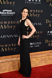 Michelle Dockery attended the New York premiere of 'Downton Abbey' wearing a black Armani Privé gown that was minimalist from the front but vampy at the back.