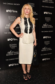 Courtney Love may have worn a cocktail dress for the screening of 'Ain't Them Body Saint,' but she still stayed true to her punk roots by opting for a black lace embellished frock.