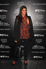 Rachel Roy's bold patterned button down added spice to her black pantsuit.