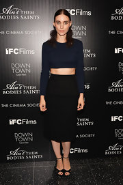 Rooney went the minimal route with a navy blue long-sleeve crop top.