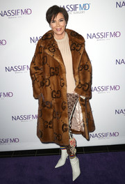 Kris Jenner looked posh in a tan Gucci fur coat at the grand opening of Dr. Paul Nassif's new medical spa.