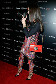 Georgina Chapman donned a pair of paisley-print pants and a matching blouse for the screening of 'A Dream of Flying.'