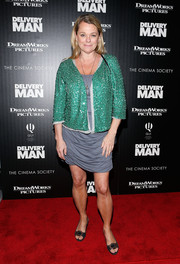 Debbie Bancroft dressed up her gray dress with a sequined green jacket for the 'Delivery Man' screening in NYC.