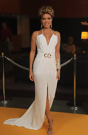 Sylvie van der Vaart looked like a goddess in a long white Grecian gown with gold accents.