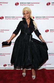 Misa Hylton Brim chose a classic, retro-style dress with a three-quarter-length sleeve and high collar.