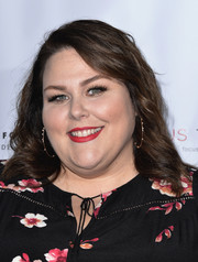 Chrissy Metz wore her hair down to her shoulders in feathery waves at the Shop for Success VIP event.