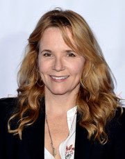 Lea Thompson sported high-volume curls with side-swept bangs at the Shop for Success VIP event.