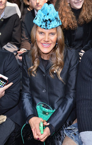 Queen of hats Anna dello Russo chose a triangular blue fur cap for the Dsquared2 fashion show.