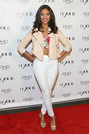 Ryli flaunted her shapely figure in tight white jeans.