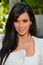 Kim Kardashian kept her makeup minimal at DuJour Magazine's Spring issue celebration, opting for only long, luscious lashes.