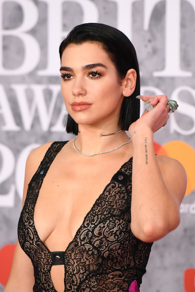 Dua Lipa Statement Ring [hair,clothing,beauty,lip,brassiere,hairstyle,black hair,cheek,eyelash,premiere,red carpet arrivals,brit awards,london,england,the o2 arena,dua lipa]