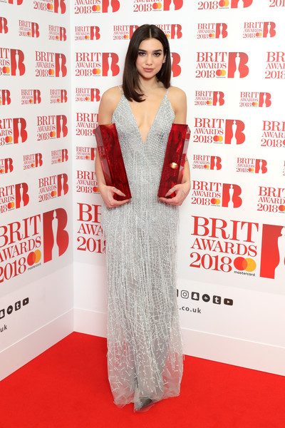 Dua Lipa Embroidered Dress [red carpet,carpet,clothing,dress,flooring,red,premiere,fashion model,fashion,long hair,winner,act awards,room,winners room,the o2 arena,england,dua lipa,british female solo artist,brit awards,british breakthrough]