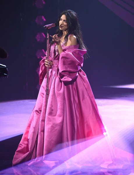 Dua Lipa Princess Gown [image,microphone,dress,purple,thigh,musician,music artist,concert,violet,performing arts,music,dress,telecast,statistics,microphone,purple,los angeles,california,annual grammy awards,event,fashion show,haute couture,gown,fashion,fashion model,magenta telekom,event,beauty.m]