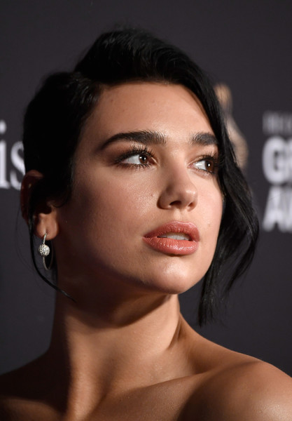 Dua Lipa Diamond Hoops [face,hair,eyebrow,lip,chin,skin,hairstyle,cheek,beauty,head,clarence avant,arrivals,grammy salute to industry icons,beverly hills,california,the beverly hilton hotel,dua lipa,pre-grammy gala]