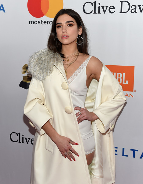 Dua Lipa Red Nail Polish [salute to industry icons,white,clothing,beauty,fashion,fashion design,dress,carpet,flooring,formal wear,beige,jay-z,dua lipa,arrivals,clive davis,grammy,grammy salute to industry icons,recording academy pre-grammy gala,new york city]