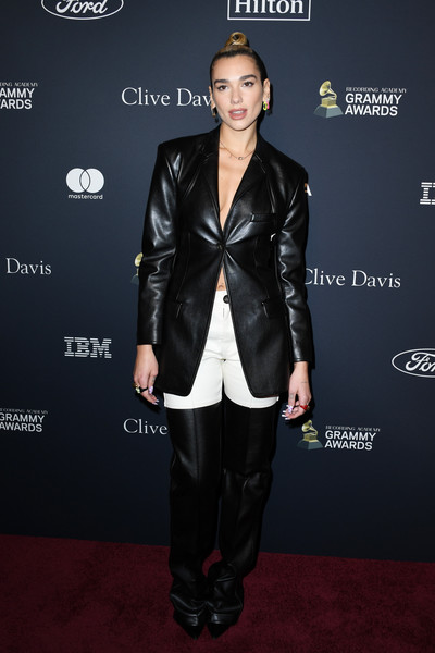 Dua Lipa Pantsuit [clothing,leather,suit,carpet,fashion,jacket,outerwear,leather jacket,footwear,textile,sean ``diddy combs,arrivals,grammy salute to industry icons,the beverly hilton hotel,beverly hills,california,dua lipa,pre-grammy gala,dua lipa,60th annual grammy awards,staples center,the recording academy,musician,grammy award for best new artist,hawtcelebs,2018,grammy awards,clive davis]