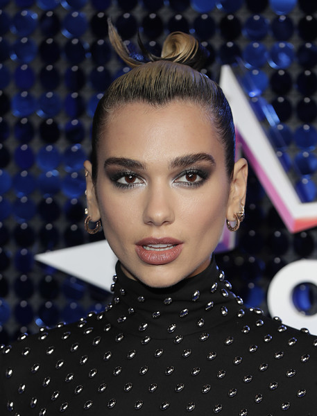 Dua Lipa Hair Knot [hair,eyebrow,face,hairstyle,fashion,forehead,beauty,lip,eye,eyelash,red carpet arrivals,global awards,eventim apollo,london,england,hammersmith,dua lipa,the global awards,long hair,hair m,haute couture,supermodel,hair,forehead,black hair,purple,02pd - circolo del partito democratico di milano,socialite]