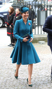 Kate Middleton contrasted her teal frock with green pumps by Emmy London.