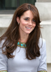 Kate Middleton donned a long layered cut with sweeping bangs to frame her face for an elegant look.