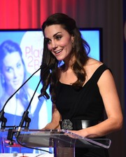 Kate Middleton cinched in her waist with a crystal and bow-embellished belt by Temperley London for the Place2Be Wellbeing in Schools Awards.