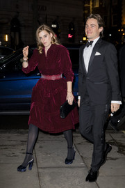 Princess Beatrice finished off her ensemble with a black croc-embossed clutch.