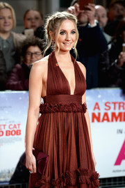 Joanne Froggatt arrived for the UK premiere of 'A Street Cat Named Bob' carrying an elegant burgundy envelope clutch.