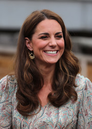 Kate Middleton kept it sweet with this long curly 'do while attending a photography workshop with Action for Children.