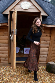 Kate Middleton visited the Ely & Caerau Children's Centre in Cardiff, Wales wearing a leopard-print skirt by Zara along with a black turtleneck.