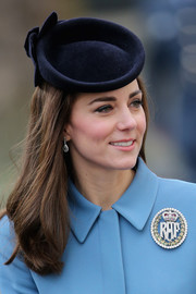 Kate Middleton accessorized with a dark blue decorative hat by Lock & Co. for the 75th anniversary of the RAF Air Cadets.