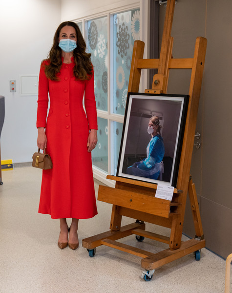 Kate Middleton looked bright and stylish in a red Eponine coat while visiting the Royal London Hospital Whitechapel.