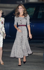 Kate Middleton looked charming in a gray Erdem glen plaid dress with a purple belt and an asymmetrical neckline at the opening of the V&A Photography Centre.