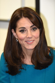 Kate Middleton styled her hair with an off-center part and flippy ends for her visit to Action on Addiction.