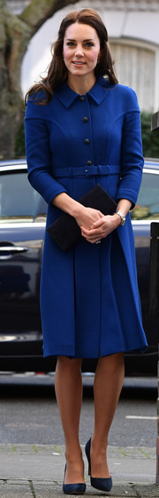 Kate Middleton was impeccably dressed in a cobalt wool coat by Eponine while visiting the Anna Freud Centre.