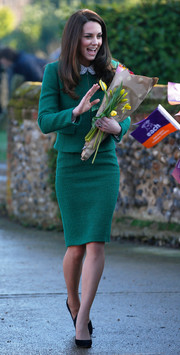 Kate Middleton kept it conservative in a green skirt suit by Hobbs while visiting East Anglia's Children's Hospices.