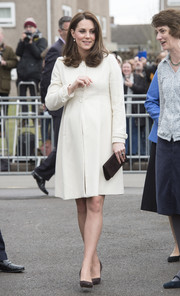 Kate Middleton teamed brown suede pumps with a white maternity coat for her visit to Family Links.