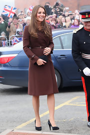 Kate Middleton was ever the lady in this knee-length wool coat and matching belt, which she wore to an appearance at the National Fishing Heritage Centre.