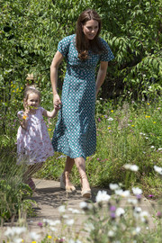 Kate Middleton looked lovely in a teal print midi dress by Sandro at the Hampton Court Flower Festival.