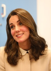 Kate Middleton sported her signature bouncy curls while visiting the Hornsey Road Children's Centre.