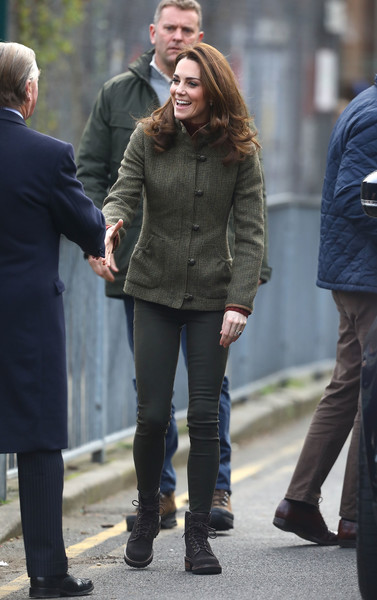 Kate Middleton geared up for the outdoors in a fitted tweed jacket by Dubarry while visiting Islington Community Garden.