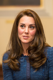 Kate Middleton visited Kings College Hospital wearing a side-parted hairstyle with bouncy, curly ends.
