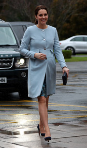 Kate Middleton showed off her sweet pregnancy style with this baby-blue coat by Seraphine while visiting Kings College London.