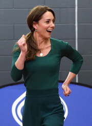 Kate Middleton matched a ribbed green scoopneck sweater by Mango with a pair of wide-leg pants for a SportsAid Stars event.
