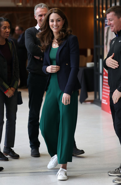 Kate Middleton teamed green wide-leg pants by Zara with a matching top and a navy blazer for a SportsAid Stars event.