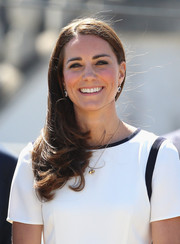 Kate Middleton kept it simple with a side-parted 'do with feathered ends when she visited the National Maritime Museum.