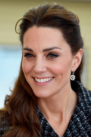 Kate Middleton looked so beautiful wearing this half updo while attending a National Portrait Gallery workshop.